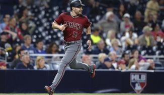 Arizona Diamondbacks' A.J. Pollock looks back as he heads home on a two-run single by Archie Bradley during the eighth inning of a baseball game against the San Diego Padres on Wednesday, Sept. 20, 2017, in San Diego. (AP Photo/Orlando Ramirez)