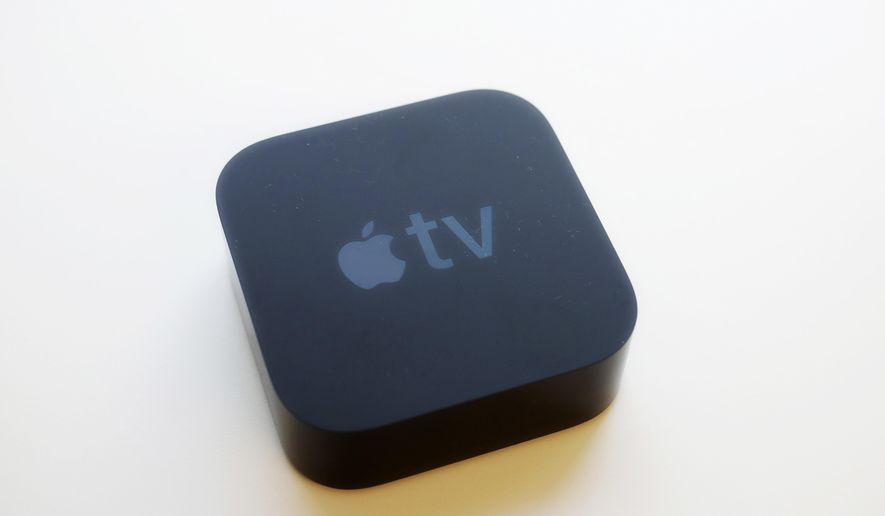 In this Friday, Sept. 15, 2017 photo, the Apple TV is displayed, in New York. The new Apple TV streaming device heralds the onset of ultra high-definition 4K video for the mass audience. (AP Photo/Mark Lennihan)
