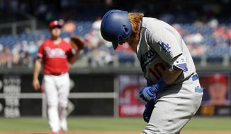 Los Angeles Dodgers' Justin Turner, right, reacts after getting hit by a pitch from Philadelphia Phillies starting pitcher Mark Leiter Jr. during the first inning of a baseball game, Thursday, Sept. 21, 2017, in Philadelphia. (AP Photo/Matt Slocum)