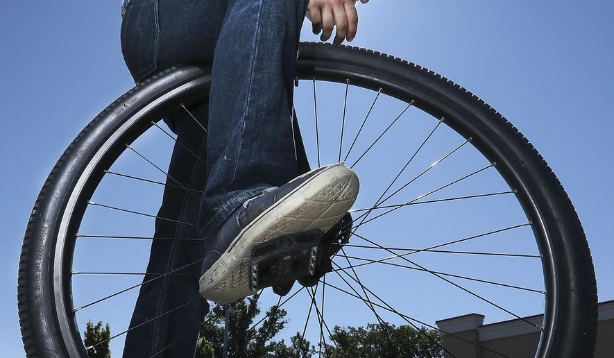 ADVANCE FOR THE WEEKEND OF SEPT. 23-24 AND THEREAFTER - In a Friday, Sept. 8, 2017 photo, Ron Barribeau, 21, of Eau Claire, Wis., poses for photos in the Woodman's parking lot in Altoona, Wis.  Barribeau rides his unicycle two miles to work at Woodman's in Altoona, Wis. (Marisa Wojcik/The Eau Claire Leader-Telegram via AP)