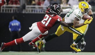 FILE - In this Sunday, Sept. 17, 2017, file photo, Green Bay Packers wide receiver Randall Cobb (18) makes the catch as Atlanta Falcons cornerback Desmond Trufant (21) closes in during the first of an NFL football game in Atlanta. Trufant is playing at full capacity after missing the Falcons' playoff run last year with a torn pectoral he suffered in November. The 2015 Pro Bowl cornerback says he's making up for lost time. (AP Photo/David Goldman), File)
