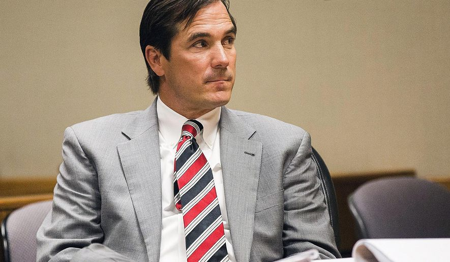 FILE - In this Aug, 10, 2017, file photo, Nick Lyon, director of the Michigan Department of Health and Human Services, appears in Genesee County District Court in Flint, Mich. Lyon, who is blamed in the death of a Flint-area man who had Legionnaires' disease faces a key hearing starting Thursday, Sept. 21, 2017, to determine whether he will stand trial for involuntary manslaughter. He's accused of failing to alert the public in a timely manner about a Legionnaires' outbreak in the Flint area in 2014-15. (Terray Sylvester/The Flint Journal-MLive.com via AP, File)