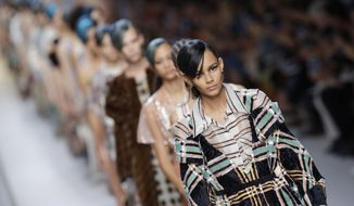 Models wear creations as part of the Fendi womens Fall/Winter 2018/19 fashion collection, presented in Milan, Italy, Thursday, Sept. 21, 2017. (AP Photo/Luca Bruno)