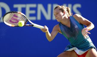 Barbora Strycova of the Czech Republic returns a shot to Johanna Konta of Britain during their second round match of the Pan Pacific Open tennis tournament in Tokyo, Thursday, Sept. 21, 2017. (AP Photo/Shizuo Kambayashi)