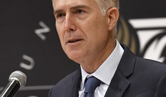 Justice Neil Gorsuch speaks to an audience as a guest of Senator Mitch McConnell, R-Ky., at the University of Louisville, Thursday, Sept. 21, 2017, in Louisville, Ky. (AP Photo/Timothy D. Easley)