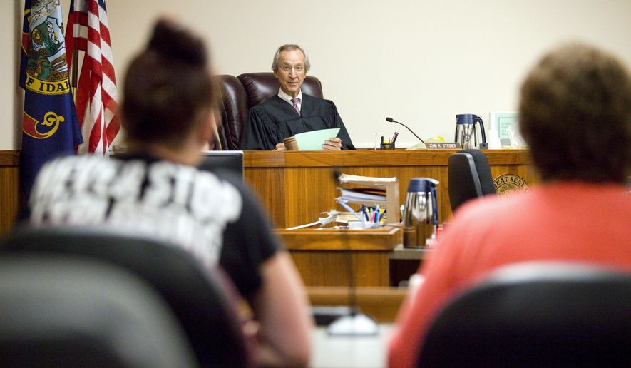 Int his Monday, Sept. 11, 2017 photo, Judge John Stegner talks with Starr Olson, left, and her attorney, Cathy Mabbutt, during Latah County Mental Health Court in Moscow, Idaho. (Geoff Crimmins/The Moscow-Pullman Daily News via AP)