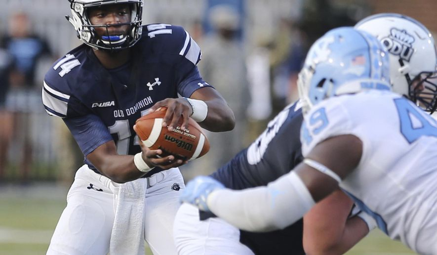 In this Saturday, Sept. 16, 2017 photo, Old Dominion quarterback Steven Williams Jr. takes a snap during an NCAA college football game against North Carolina in Norfolk, Va. Old Dominion coach Bobby Wilder was looking for an offensive spark when he sent 17-year-old freshman Steven Williams Jr. into last weekend's game against North Carolina. What he thinks he found instead is a quarterback.  (AP Photo/Jason Hirschfeld, File)