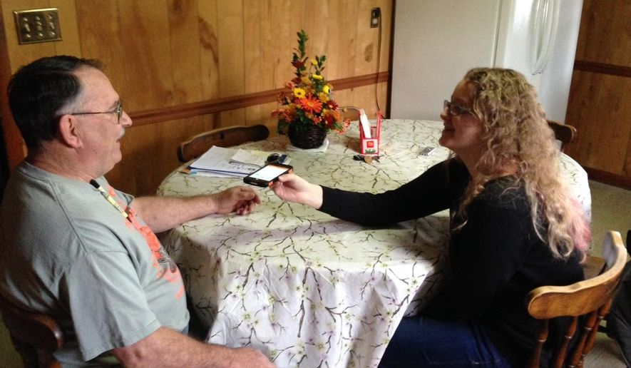 FILE - In this Nov. 27, 2015, file photo, Rhiannon Leonard interviews her boss, Gary Himes in Weverton, Md., for StoryCorps' Great Thanksgiving Listen oral history project. The Great Thanksgiving Listen will be held for a third year in 2017. The event calls for high school students to record a conversation with an elder over the holiday weekend using the StoryCorps app. (AP Photo/David Dishneau, File)