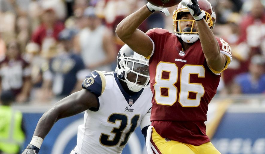 Washington Redskins tight end Jordan Reed, right, catches as Los Angeles Rams strong safety Maurice Alexander looks on during the first half of an NFL football game Sunday, Sept. 17, 2017, in Los Angeles. (AP Photo/Jae C. Hong)