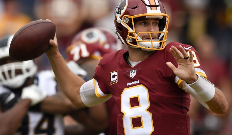 Washington Redskins quarterback Kirk Cousins passes against the Los Angeles Rams during the first half of an NFL football game Sunday, Sept. 17, 2017, in Los Angeles. (AP Photo/Kelvin Kuo)