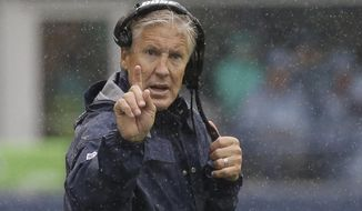 FILE - In this Sunday, Sept. 17, 2017, file photo, Seattle Seahawks head coach Pete Carroll gestures from the sideline in the rain during the first half of an NFL football game against the San Francisco 49ers in Seattle. Carroll has been studying Dick LeBeau since he went into coaching himself, and now the Seattle head coach finds himself facing off again against the defensive coordinator now with the Tennessee Titans. (AP Photo/Elaine Thompson, File)