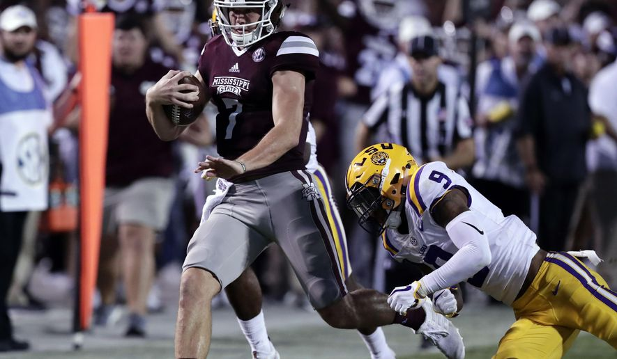 FILE - In this Sept. 16, 2017, file photo, Mississippi State quarterback Nick Fitzgerald (7) sprints past LSU safety Grant Delpit (9) for a first down during the second half of their NCAA college football, in Starkville, Miss. No. 17. Mississippi State plays at No. 11 Georgia on Saturday, Sept. 23. The first matchup between the SEC's two sets of Bulldogs since 2011 features a pair of undefeated teams. (AP Photo/Rogelio V. Solis, File)