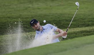 Kyle Stanley hits out of the bunker on the 18th hole during the first round of the Tour Championship golf tournament at East Lake Golf Club in Atlanta, Thursday, Sept. 21, 2017. (AP Photo/David Goldman)