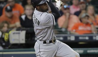 Chicago White Sox's Tim Anderson watches a home run against the Houston Astros during the eighth inning of a baseball game Thursday, Sept. 21, 2017, in Houston. (AP Photo/David J. Phillip)