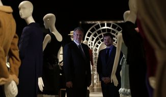 Luca Dotti right, and Sean Hepburn-Ferrer, sons of the iconic actress Audrey Hepburn, stand by some their mothers possessions at Christie's auction house in London, Friday, Sept. 22, 2017. Hepburn's sons Luca Dotti and Sean Hepburn-Ferrer are jointly selling some of their mothers personal possessions at auction on Sept. 27. (AP Photo/Alastair Grant)