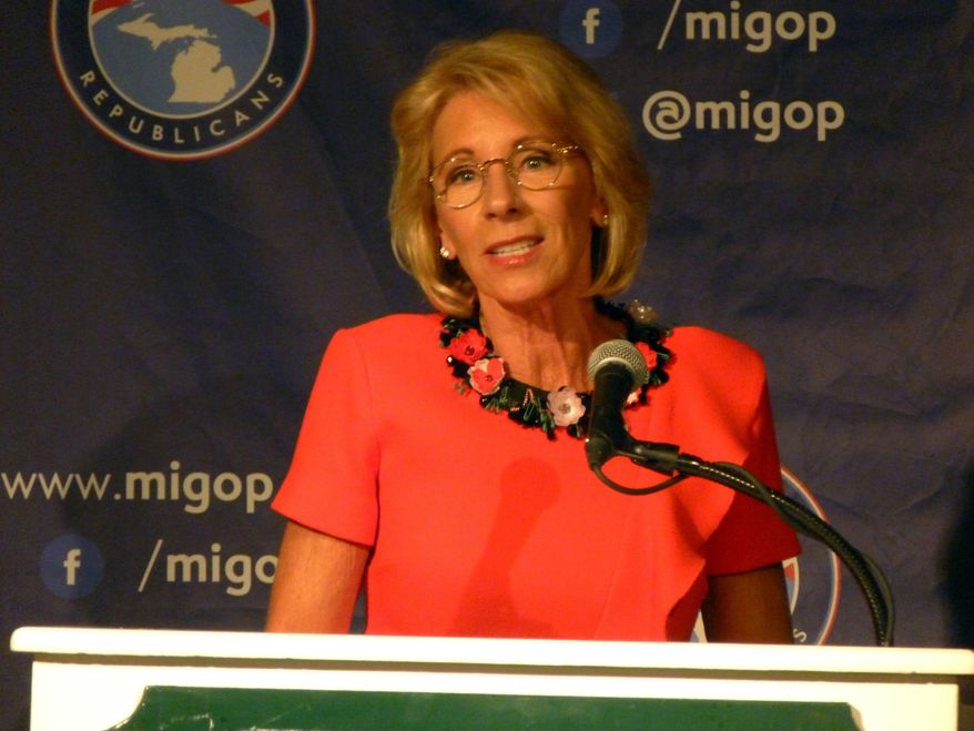 """Education Secretary Betsy DeVos speaks on Friday, Sept. 22, 2017 at the Mackinac Republican Leadership Conference on Mackinac Island, Mich. DeVos said Obama-era guidance on investigating campaign sexual assaults """"didn't work for anyone."""" (AP Photos/David Eggert)"""
