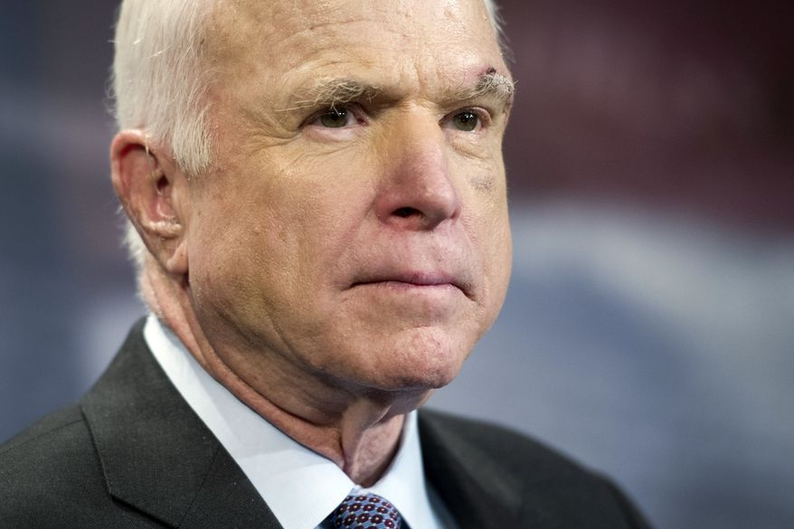 FILE - In this July 27, 2017, file photo, Sen. John McCain, R-Ariz., speaks to reporters on Capitol Hill in Washington.  McCain says he won't vote for the Republican bill repealing the Obama health care law. His statement likely deals a fatal blow to the last-gasp GOP measure in a Senate showdown expected next week.   (AP Photo/Cliff Owen, file)