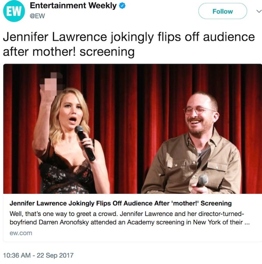 Actress Jennifer Lawrence presents her middle finger for critics of her new movie 'mother!' while at the Museum of Modern Art in New York City, Sept. 21, 2017. Audiences have called it anti-Christian and gave an 'F' on CinemaScore. (Image: Twitter, Entertainment Weekly)