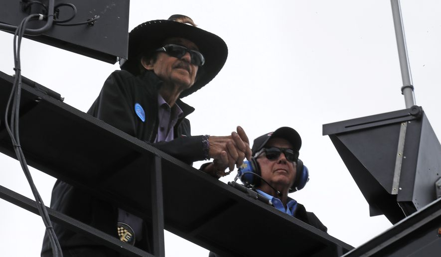 Racing legend Richard Petty, left, watches practice with Roger Penske prior to qualifying for the NASCAR Cup Series 300 auto race at New Hampshire Motor Speedway in Loudon, N.H., Friday, Sept. 22, 2017. (AP Photo/Charles Krupa)