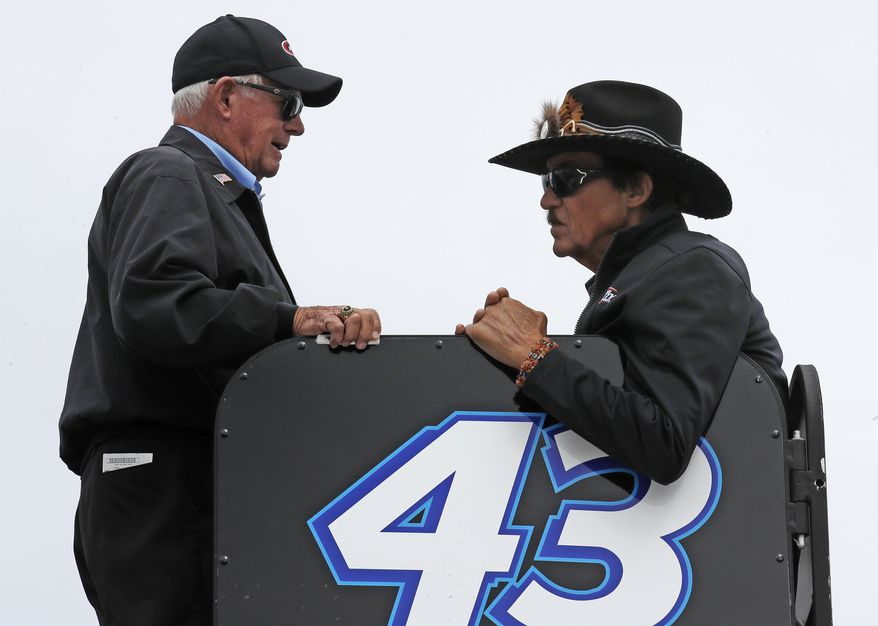 Racing legend Richard Petty, right, talks with Roger Penske prior to qualifying for the NASCAR Cup Series 300 auto race at New Hampshire Motor Speedway in Loudon, N.H., Friday, Sept. 22, 2017. (AP Photo/Charles Krupa)