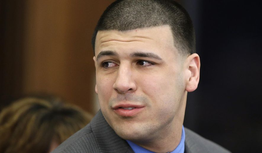 FILE - In this April 14, 2017 file photo, former New England Patriots tight end Aaron Hernandez reacts to his double murder acquittal after the sixth day of jury deliberations at Suffolk Superior Court in Boston. Hernandez's lawyer said Thursday, Sept. 21, 2017,  the former New England Patriots tight end's brain showed severe signs of the degenerative brain disease chronic traumatic encephalopathy. (AP Photo/Stephan Savoia, Pool, File)