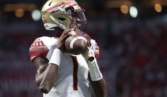 FILE - In this Sept. 2, 2017, file photo, Florida State quarterback James Blackman warms up before an NCAA college football game against Alabama in Atlanta.  The Seminoles are expected to start Blackman at quarterback against North Carolina State on Saturday. (Joe Rondone/Tallahassee Democrat via AP, File)
