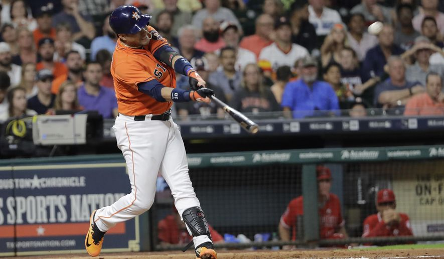 Houston Astros' Yuli Gurriel hits a three-run home run against the Los Angeles Angels during the seventh inning of a baseball game Friday, Sept. 22, 2017, in Houston. (AP Photo/David J. Phillip)