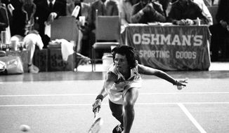 FILE - In this Sept. 20, 1973, file photo, Billie Jean King reaches to hit a return during her match against Bobby Riggs in the Astrodome in Houston, Texas. King beat Riggs 6-4, 6-3, 6-3. (AP Photo/File)