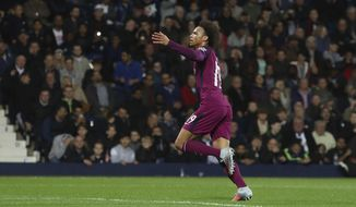 Manchester City's Leroy Sane, celebrates scoring his side's second goal of the game during the League Cup Third Round soccer match, West Bromwich Albion versus Manchester City at The Hawthorns, West Bromwich, England, Wednesday Sept. 20, 2017. (David Davies/PA vi