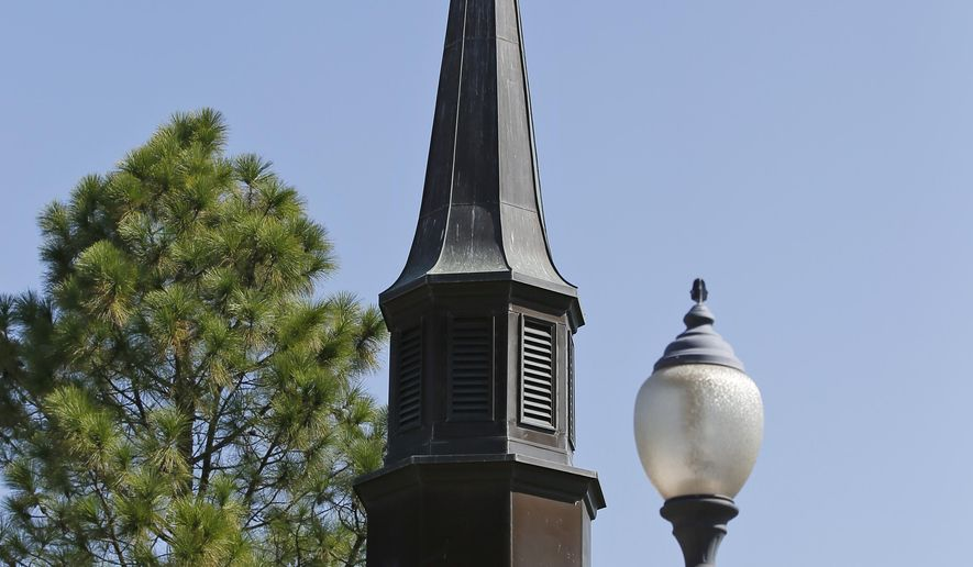 In this Thursday, Sept. 14, 2017 photo, the cross on a steeple of a chapel on the campus of East Central University is pictured in Ada, Okla. The small chapel nestled on a university campus in a rural central Oklahoma town is at the center of a public firestorm over the use of religious symbols on public property after a Washington, D.C.-based group insisted that a cross be removed from atop its steeple. (AP Photo/Sue Ogrocki)
