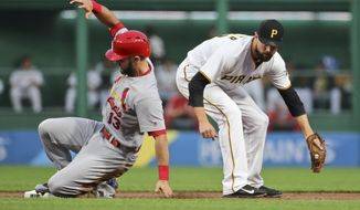 St. Louis Cardinals' Matt Carpenter (13) slides into second with a double ahead of the tag by Pittsburgh Pirates shortstop Jordy Mercer during the first inning of a baseball game, Friday, Sept. 22, 2017, in Pittsburgh. (AP Photo/Keith Srakocic)