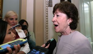 Sen. Susan Collins, R-Maine, speaks with reporters before heading into a policy luncheon on Capitol Hill, Tuesday, Sept. 19, 2017 in Washington. (AP Photo/Alex Brandon)