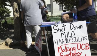 """A group has put up flyers and a booth on Sproul Plaza calling for protesters to """"Shut Down Milo Yiannopoulos"""" at the University of California, Berkeley campus in Berkeley, Calif.  (AP Photo/Jocelyn Gecker) ** FILE **"""