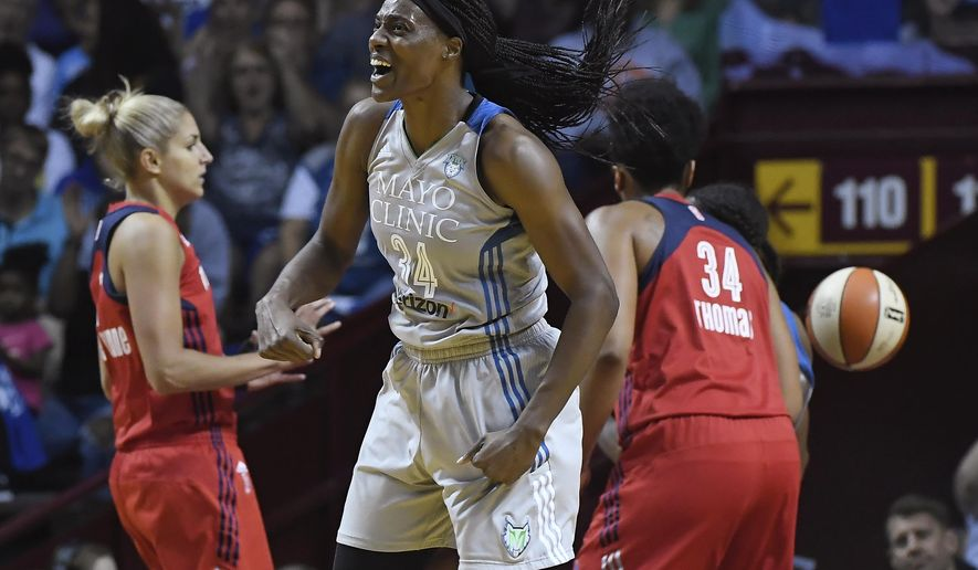 FILE - In this Sept. 14, 2017, file photo, Minnesota Lynx center Sylvia Fowles (34) celebrates after scoring against the Washington Mystics during the first half of Game 2 of the WNBA basketball semifinals in Minneapolis. While Fowles was sitting out the 2015 season waiting for a trade, the 2017 WNBA MVP spent a lot of time cycling. It was a chance for her to stay in shape and keep her mind focused on other things besides basketball. Now she's giving others a chance to cycle, donating a portion of her MVP bonus to Cycles for Change. It's a local organization that gives girls access to bicycles. (Aaron Lavinsky/Star Tribune via AP, File)