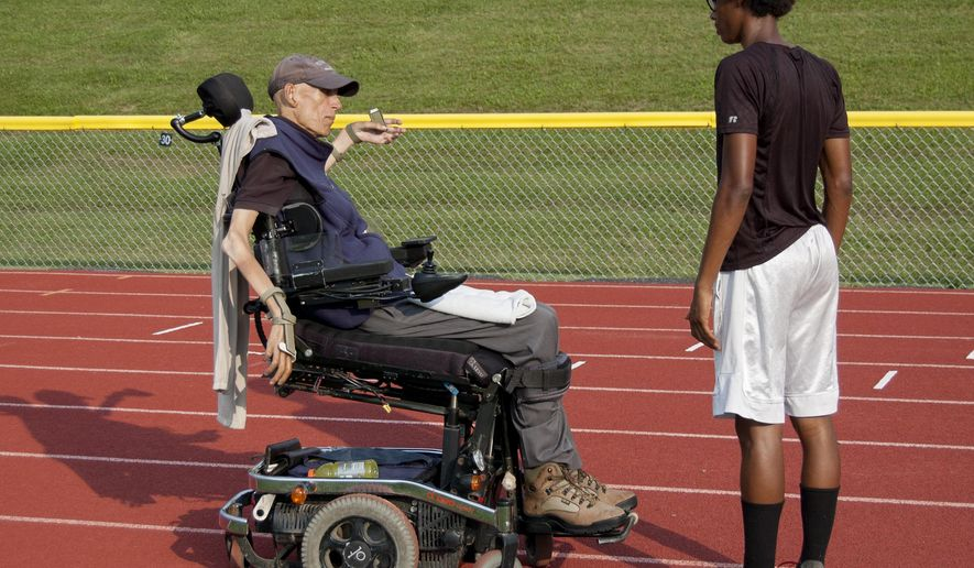 ADVANCE FOR SATURDAY SEPT. 23 AND THEREAFTER - In a July 11, 2017 photo, Tom Kleban instructs Stanley Hamilton on the hurdles during a summer track session.  (Gordon Brunskill /Centre Daily Times via AP)