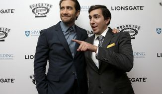 "FILE- In this Sept. 12, 2017, file photo, actor Jake Gyllenhaal, left, and Boston Marathon bombing survivor Jeff Bauman, right, arrive on the red carpet at the U.S. premiere of the movie ""Stronger"" at the Spaulding Rehabilitation Hospital, where Bauman and others who were injured in the 2013 deadly attack were treated in Boston. Gyllenhaal plays Bauman in the film, which opens Friday, Sept. 22, at theaters nationwide. (AP Photo/Steven Senne, File)"
