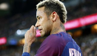 Paris Saint Germain's Neymar looks on during their French League One soccer match between PSG and Olympique Lyon at the Parc des Princes stadium in Paris, France, Sunday, Sept. 17, 2016. (AP Photo/Francois Mori)