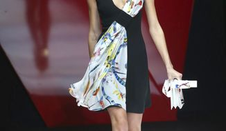 A model wears a creation as part of the Giorgio Armani womens Fall/Winter 2018/19 fashion collection, presented in Milan, Italy, Friday, Sept. 22, 2017. (AP Photo/Antonio Calanni)