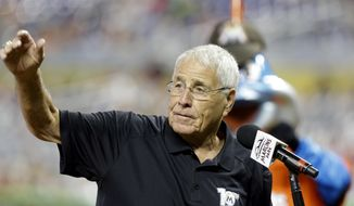 FILE - In this Aug. 4, 2013, file photo, former Florida Marlins manager Jack McKeon waves to the crowd during a ceremony honoring the 2003 Florida Marlins World Series team in Miami. McKeon says he has been told he will not be retained by the new ownership group that includes Derek Jeter. McKeon managed the Marlins when they won the World Series in 2003 and for the past 12 seasons has been a special assistant to owner Jeffrey Loria. (AP Photo/Lynne Sladky, File)