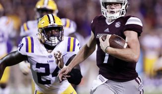 FILE- In this Sept. 16, 2017, file photo, Mississippi State quarterback Nick Fitzgerald (7) sprints past LSU linebacker Tyler Taylor (24) for a first down during the second half of an NCAA college football game in Starkville, Miss.  In a game between unfamiliar rivals sharing little beyond a nickname, No. 11 Georgia hosts No. 17 Mississippi in an early season showdown that will help shake out the balance of the power in the SEC. (AP Photo/Rogelio V. Solis, File)