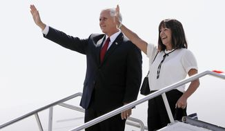 Vice President Mike Pence and his wife, Karen, wave to guests after arriving on Air Force Two, Friday, Sept. 22, 2017, in Indianapolis. Vice President Pence will make the Republican case for a federal tax code overhaul during a speech Friday, Sept. 22 in his home state of Indiana. (AP Photo/Darron Cummings)