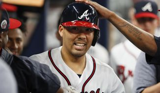 Atlanta Braves Kurt Suzuki celebrates after hitting a solo home run in the seventh inning of a baseball game against the Philadelphia Phillies, Friday, Sept. 22, 2017, in Atlanta. (AP Photo/Todd Kirkland)