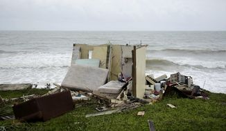 A completely ruined house is seen in El Negro community a day after the impact of Hurricane Maria, in Puerto Rico, Thursday, September 21, 2017. As of Thursday evening, Maria was moving off the northern coast of the Dominican Republic with winds of 120 mph (195 kph). The storm was expected to approach the Turks and Caicos Islands and the Bahamas late Thursday and early Friday. (AP Photo/Carlos Giusti)