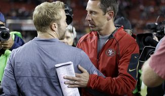 Los Angeles Rams coach Sean McVay, left, greets San Francisco 49ers coach Kyle Shanahan after an NFL football game in Santa Clara, Calif., Thursday, Sept. 21, 2017. The Rams won 41-39. (AP Photo/Ben Margot)