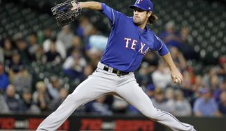 Texas Rangers starting pitcher Cole Hamels throws to the Seattle Mariners during the first inning of a baseball game Thursday, Sept. 21, 2017, in Seattle. (AP Photo/Elaine Thompson)