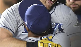 Tampa Bay Rays' Evan Longoria, facing camera is hugged by Mallex Smith after hitting a solo home run against the Baltimore Orioles in the third inning of a baseball game, Friday, Sept. 22, 2017, in Baltimore. (AP Photo/Gail Burton)