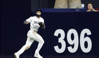 San Diego Padres center fielder Manuel Margot keeps a bubble-gum bubble on his way to making the catch for the out on Colorado Rockies' Trevor Story during the sixth inning of a baseball game Thursday, Sept. 21, 2017, in San Diego. (AP Photo/Gregory Bull)