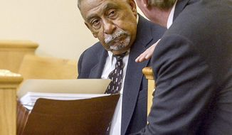 Former New Mexico state senator Phil Griego, who is charged with corruption, talks with his attorney Tom Clark before his pre-trial hearing in the Bernalillo County Courthouse, in Albuquerque, N.M., Friday, Sept. 22, 2017. (Marla Brose/Albuquerque Journal  via AP)