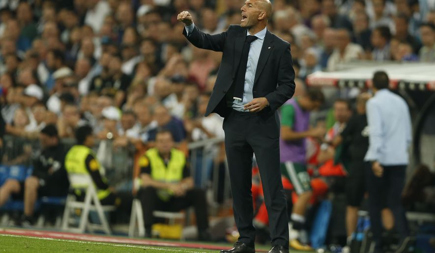 Real Madrid's head coach Zinedine Zidane gives instructions from the side line during Spanish the La Liga soccer match between Real Madrid and Real Betis at the Santiago Bernabeu stadium in Madrid, Wednesday, Sept. 20, 2017. Betis won 1-0. (AP Photo/Francisco Seco)
