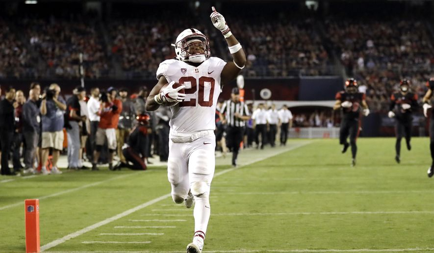 Stanford running back Bryce Love scores a touchdown during the second half of an NCAA college football game against San Diego State Saturday, Sept. 16, 2017, in San Diego. (AP Photo/Gregory Bull)